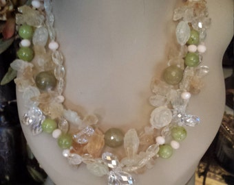 Citrine, faceted cut crystal and rosette moonstone three strand necklace