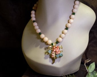 One strand beaded faceted mauve jade, green jade with vintage brooch drop