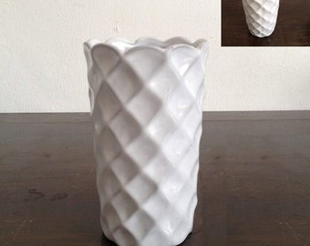 white vase for pens and pencils