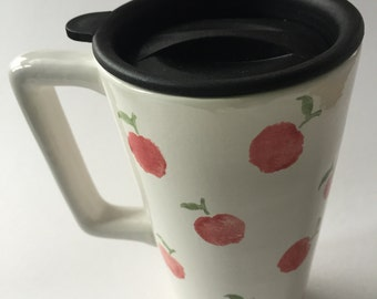Ceramic travel mug hand decorated with red apples with handle