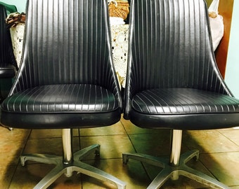 2 Vintage Swivel Chairs