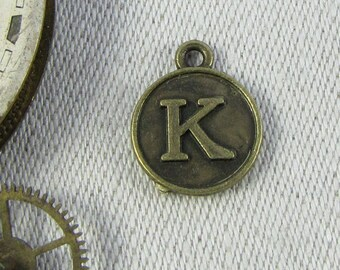 "Bronze Medallion Letter ""K"" Charm, 1 or 5 letters per package ALF012k-BZ"