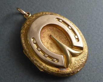 Antique  14K gold horseshoe on a 18K locket
