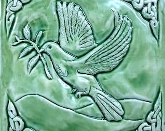 Handmade Celtic Dove of peace Ceramic tile in apple jade glaze