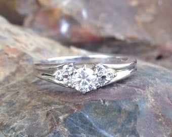 14k White gold and .37 carat diamond engagement ring with side diamonds. 2.7 gms.