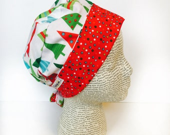 Tie Back Surgical Scrub Cap featuring a white material with re green and blue Christmas trees and a coordinating band