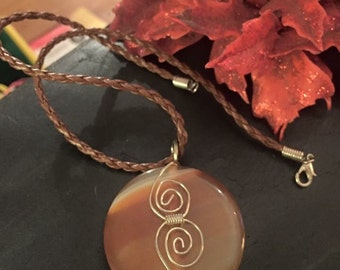 Agate wire wrap pendant on brown plaited leather necklace