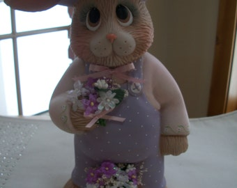 ceramic Easter Bunny Papa holding flowers