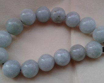 Jade bead bracelet on leather cord with silver clasp