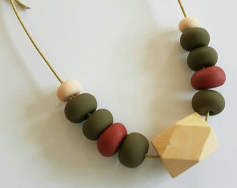Clay and wooden beaded necklace.