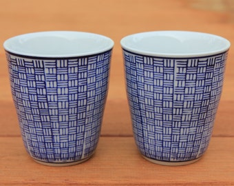 Pair of vintage white and blue tea cups