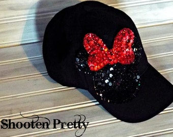 Black baseball cap with sequin Minnie Mouse silhouette and red sequin bow