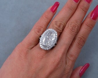 Amazing 11.63 ctw Oval Cut Diamond Engagement Ring with a 10.02 Oval Cut G Color/I1 Clarity Enhanced Center Diamond