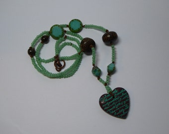 Scripted heart pendant necklace.
