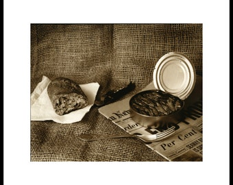Still life with canned sprats. Silver print,sepia toned