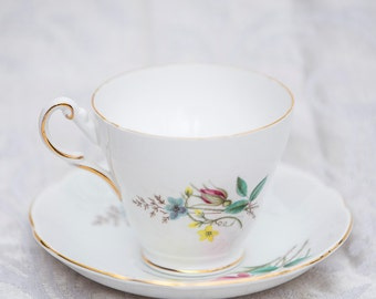 Vintage teacup and saucer with beautiful floral pattern