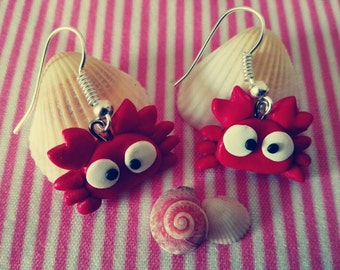 A pair of earrings of krill made by my with fimo Earrings of crabs