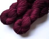 Black Doris Plum: BFL sock hand dyed yarn