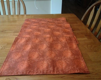 Burnt Orange placemats with brown wheat patterns. Thanksgiving/fall theme.  Six to a set.