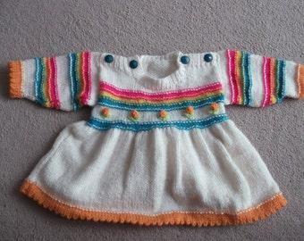 handknitted babies dress