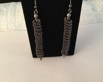 Grey coiled earrings