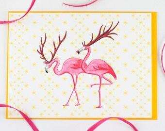 Christmas Card of Pink flamingo in santa reindeer