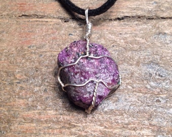 Pendant of natural stone and silver wire