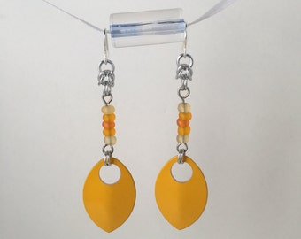 Yellow and orange bead and scale earrings