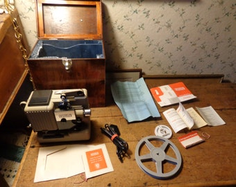 Vintage Eumig P8 automatic film projector complete with factory wooden box made in Austria