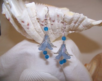 Handcrafted sapphhire recycled Sea Glass and lucite trumpet Calla Lily flower bead dangle earrings.