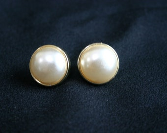 Vintage pierced earrings.  Pearl like center with gold tone metal.
