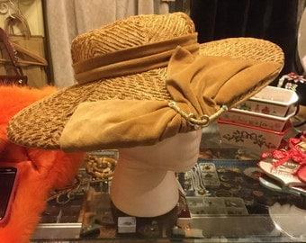 Gold mesh hat with velvet bow