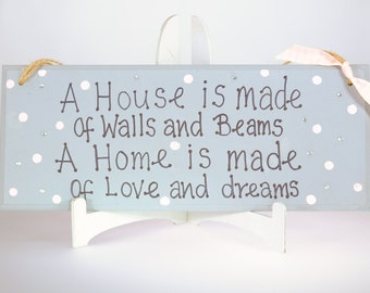 A house is made of walls and beams a home is made of love and dreams