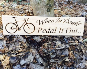 Pedal it out sign