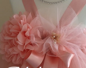 Soft and Delicate Perfectly Peach tulle tutu flower girl dress with handmade tulle flowers and bows.