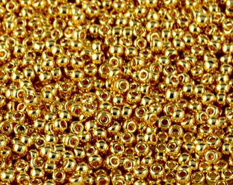 TOHO 11/0 Round Seed Beads - Metallic Gold [TR-11-712]