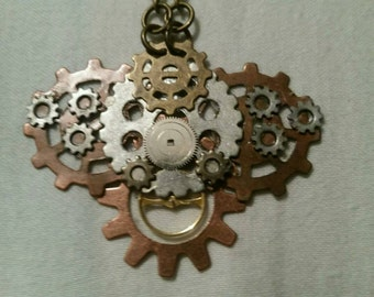 Steam Punk, Industrial Hammered copper wire, sprockets, watch parts, gears and wire Pendant on chain.