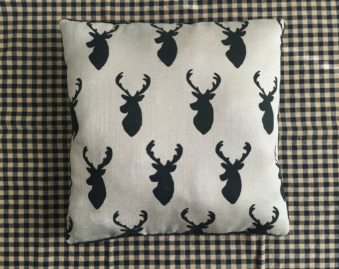 Cream and black deer shilouette pillow