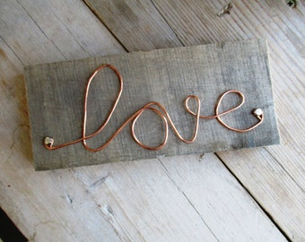HAND MADE Hand made copper wire word ' love ' on sturdy wooden scaffold plank