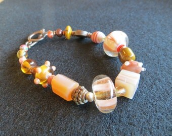 Peach Lampwork Glass Beaded Bracelet with copper accents
