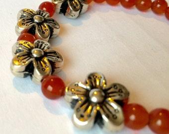 Beaded Bracelet in carnelian gem stones with silver flower detail