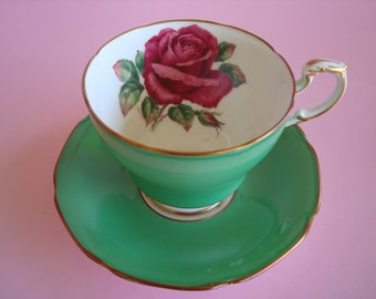 Lovely Vintage PARAGON Roses With Green Back-ground Cup & Saucer.