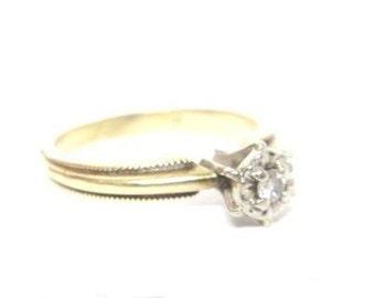 Circle cut diamond ring in 10k gold, size 5