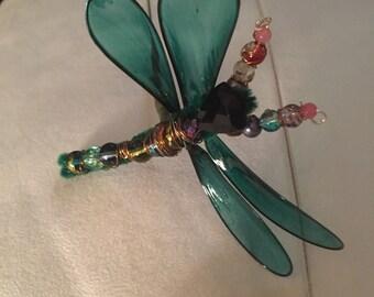 Fantasy film green Dragonfly on stick