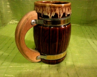 Vintage beer mug with golden metall ornament