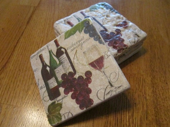 Set Of 4 Tumbled Stone Coasters Bearing Images Of A Wine