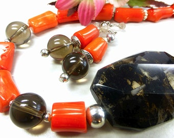 Orange coral set with smoky quartz