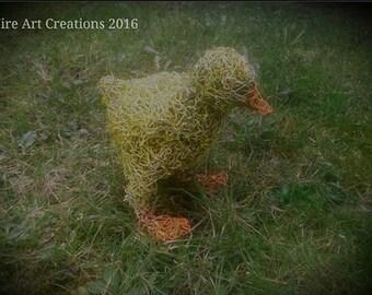Duckling sculpture handmade ftom wire.