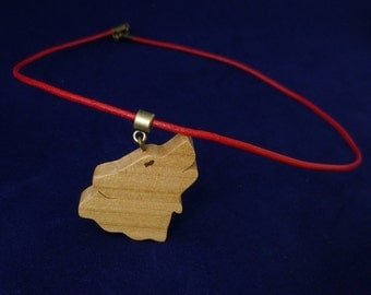 Wolf in wood and leather pendant