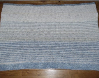 Knitted cot blanket